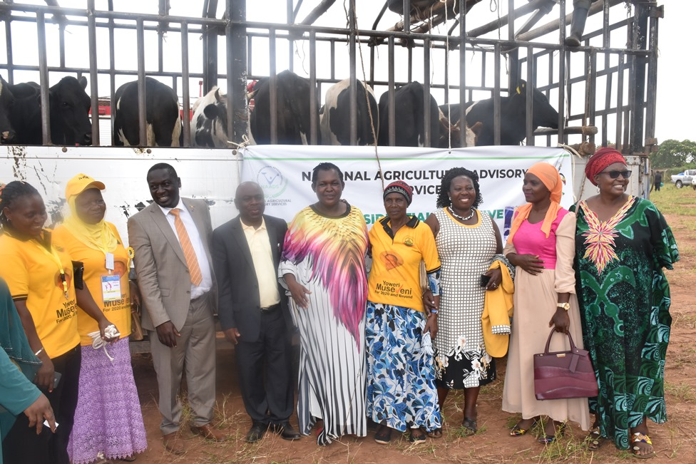 NAADS Board members with the beneficiaries of the 10 heifers in Mbale