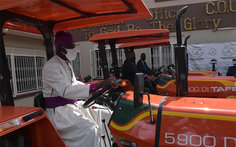 Government through NAADS hands over 5 additional Tractors to Church of Uganda